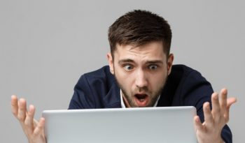 Man loos at laptop in disbelief
