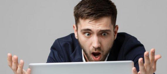 Man loos at laptop in disbelief
